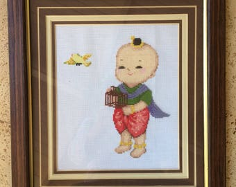Cross Stitched Picture of Asian Child