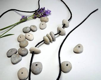Drilled pebbles (20 pieces) from the Latvian Baltic Sea coast. Pebbles with hole for necklaces and bracelets.