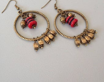 Ethnic hoops, red bead and bronze cubes, creating Leamorphoses