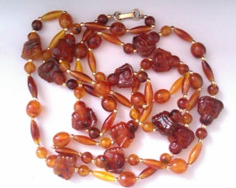 amber coloured plastic buddha bead long necklace