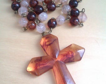 amber coloured plastic rosary beads and cross