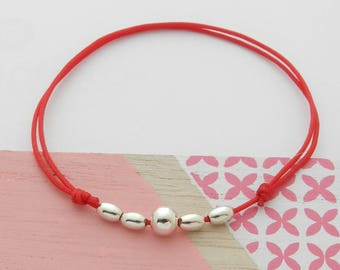 RED WITH SILVER BEADS CORD BRACELET
