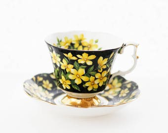"Rare Royal Albert Flora Series ""Jasmine"" black chintz teacup, saucer decorated with yellow Jasmine blossom"