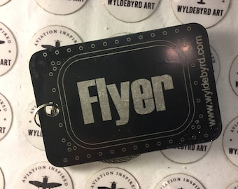 Flyer Aluminum luggage tag with Boeing aircraft window design.
