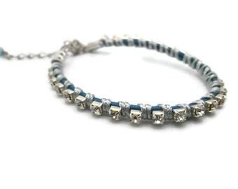Rhinestones on blue leather cord chain bracelet
