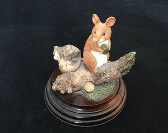 Worcester Ornamental Studio mouse on a log