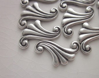 13 Vintage Antiqued Silver Brass Stampings, Swirled Stylized Leaf Design, 16mm x 9mm