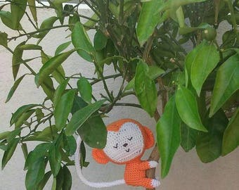 Orange crochet monkey Amigurumi