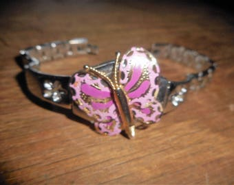 Purple and gold hues of a butterfly bracelet