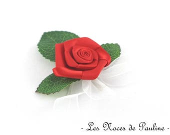 Has red and white wedding boutonniere, Rose