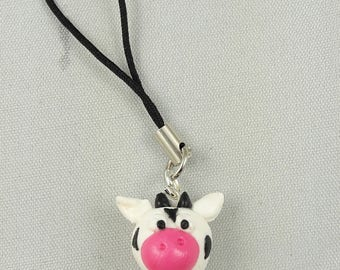 charm with small polymer clay cow