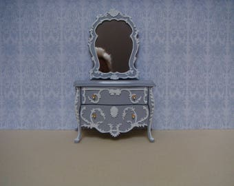 A French grey and white bomb two drawer chest.