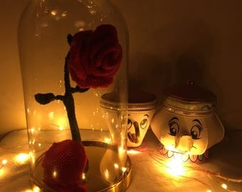 Crochet red rose in glass dome