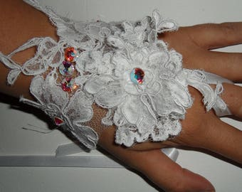Pair of white lace bridal glove.