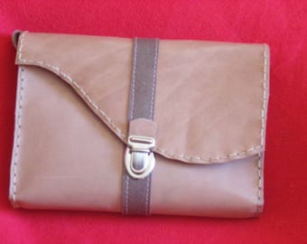small pouch in leather three in one...