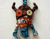 Porte-clés tête de mort Wax motif africain turquoise marron et orange