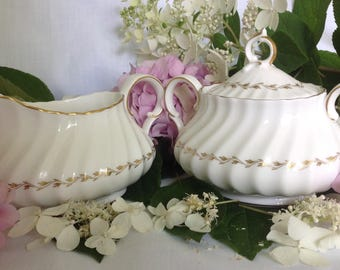 Adrian, by Royal Doulton, Creamer and Lidded Sugar Bowl, White and Gold, Oval Shape with Swirl Design, Fine Bone China, England, 1960's.