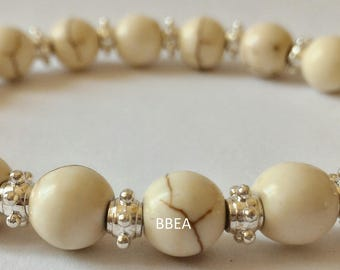 Bracelet magnesite 8 mm and Tibetan silver spacer beads