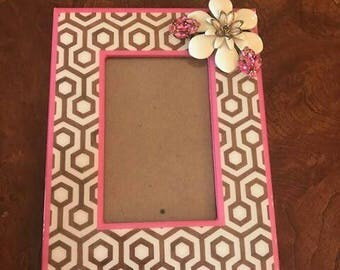 Brown pink and creme decorated picture frame. Adorned with enamel flower and vintage pink rhinestone earrings