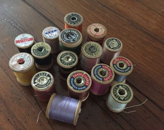 Vintage wooden spools of sewing thread
