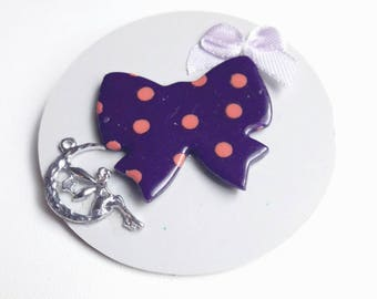 This brooch decorated with bow tie, fairy, gray, purple