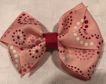 Pink polka dotted hair bow