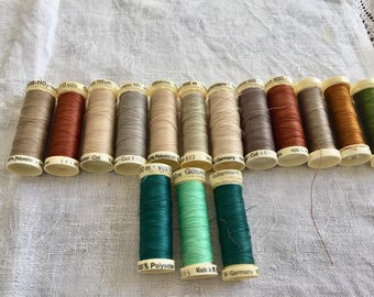 Vintage Gutermann threads. gold hues. 15 in total.