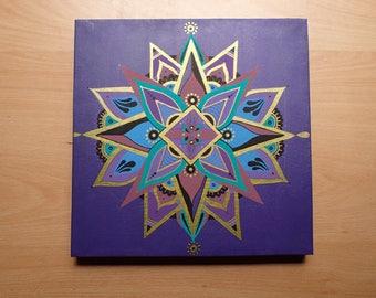 Gold mandala on purple background