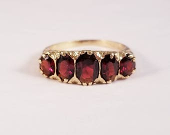 Vintage 5 stone garnet band in yellow gold
