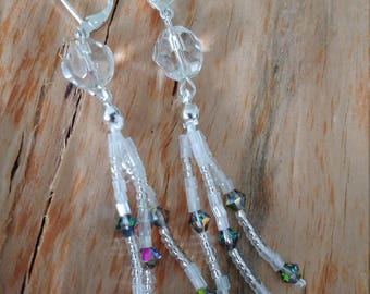 Glittering earrings with bicones and glass beads. With silver plated ear hooks.