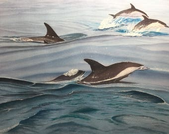 Pod of dolphins swimming in the ocean, 12x16 inches watercolor painting.