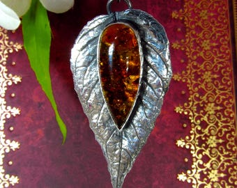 Handmade silver pendant with Baltic Amber cabochon