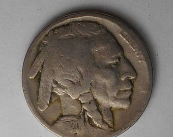Buffalo nickel U.S. 5 cent coin minted 1913-1938 realistic portrait of a Native American on one side and an image of a buffalo on the other.