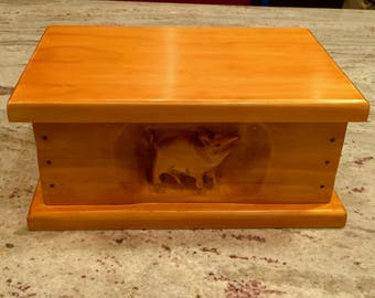 Wood storage box with pig carving