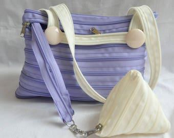 mauve/beige zipper and matching coin purse handbag