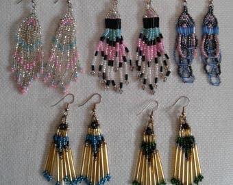 Lot of 5 pair of Southwest style pierced earrings.