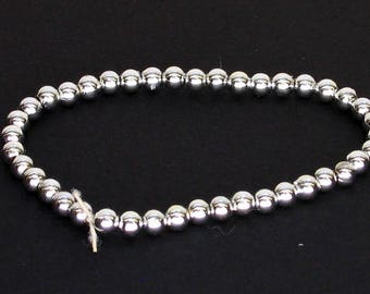 Simple Silver Colored Beaded Elastic Bracelet