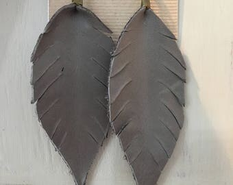 Grey leather feathers