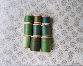 Set of nine thick cotton green thread on wooden spools produced in the Soviet Union for sewing textile, crochet in good condition