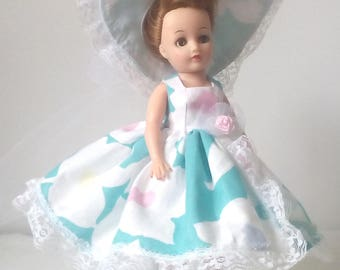 Little Miss Revlon Doll dress. Blue and white dress, trimmed with white lace, with matching hat.