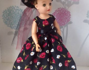 18 inch Miss Revlon doll dress. Floral pattern dress with daisies and red roses, matching hat.