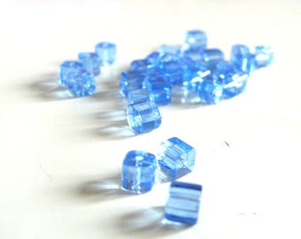 50 square light blue glass beads