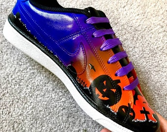 Nike custom painted Jack-air-lantern Halloween shoes.