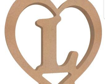 Wooden letter inside a heart. Free standing