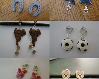 pair choice of clip earrings, windmill, horse riding saddle, ball, football, Ballet shoe, Teddy bear, Apple