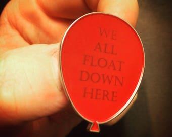 "Stephen King's IT -- ""We all Float Down Here"" enamel lapel pin"