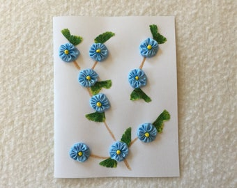 Greeting Card with a Blue Flower Vine Design