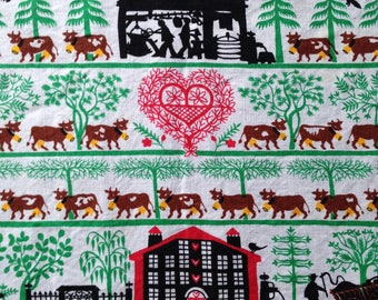 Two vintage linen placemats by Dessin Depose with amazing folk milkman graphics