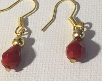Red dangle earrings. Red drop earrings. Red earrings.  Dangle earrings. Drop earrings. Gold embellishment hanging on gold ear wires.