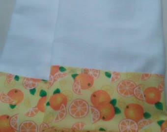Bright tea towels in yellow and orange